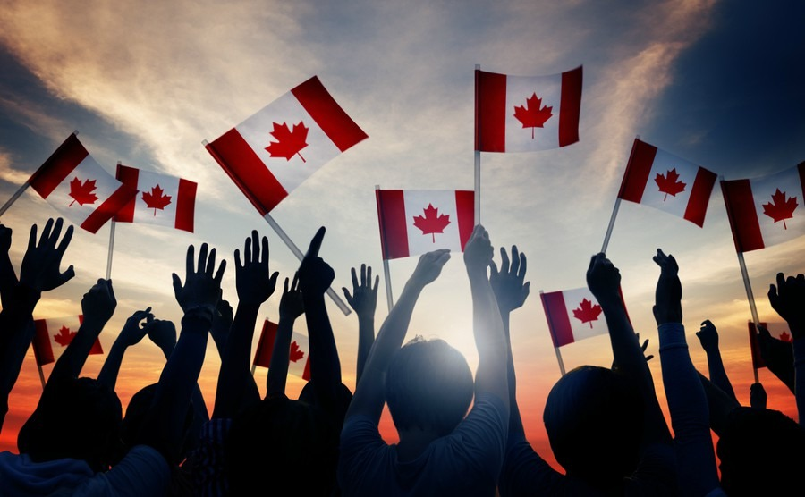 silhouettes-of-people-holding-flag-of-canada