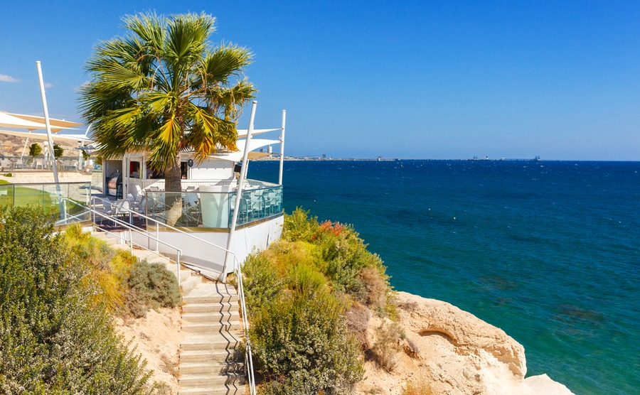Houses overlooking Governor's Beach are highly desirable. luckyraccoon / Shutterstock.com | Winter sun in Cyprus