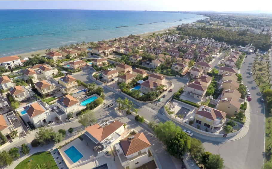 Elite cottage houses along Cyprus coastline, aerial view of beautiful seascape