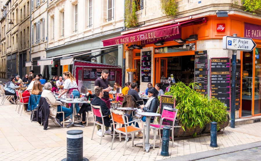 Regularly going to your local bar or café almost guarantees you'll become part of village life! kateafter / Shutterstock.com