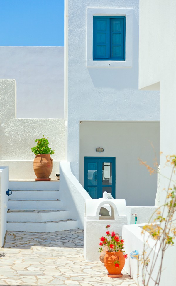 Typical White Villa Houses with blue windows in Greece