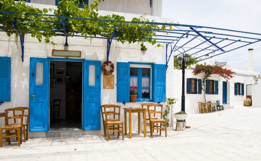 outdoor-cafe-setting-with-typical-greek-furniture-chairs