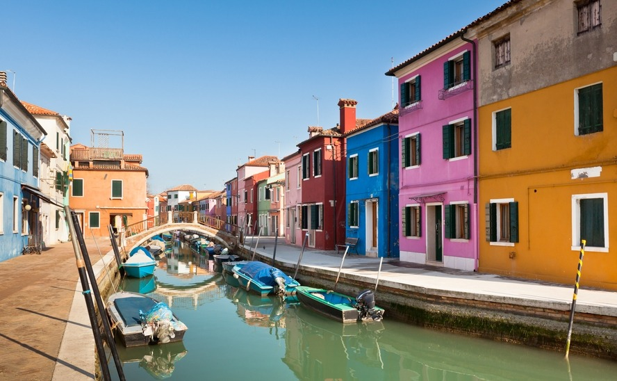 Colorful houses along canal in the island of Burano near Venice, Italy