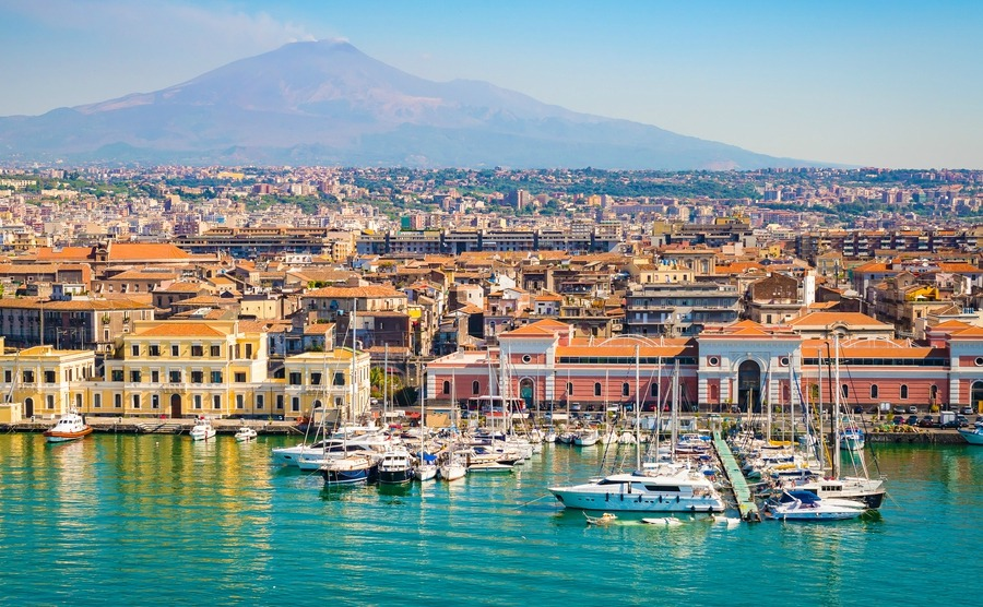 Catania's stunning natural setting and delicious cuisine are both a big plus if you're thinking of buying property in Sicily.