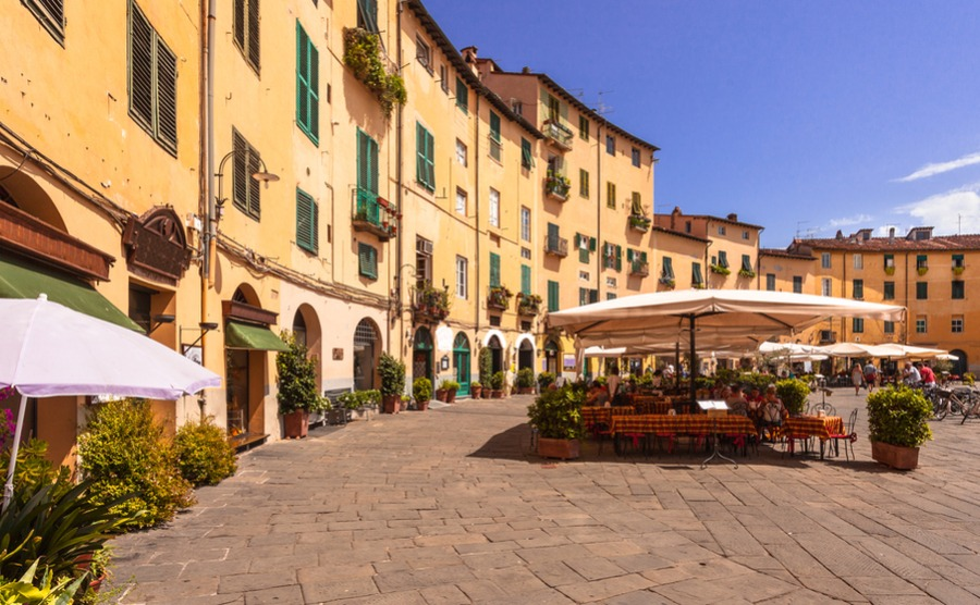 The main piazza in Lucca is actually an old amphitheatre – hence the oval shape | Best Italian cities
