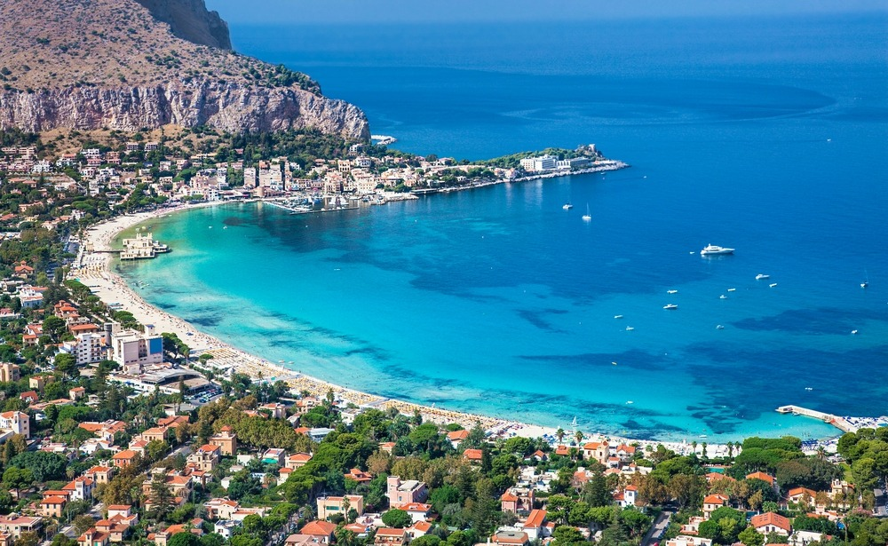 White sandy beaches like here at Mondello make Palermo another strong contender to buy property in Sicily in.