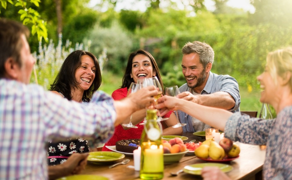 Friends in the sunshine, celebrate buying a holiday home together