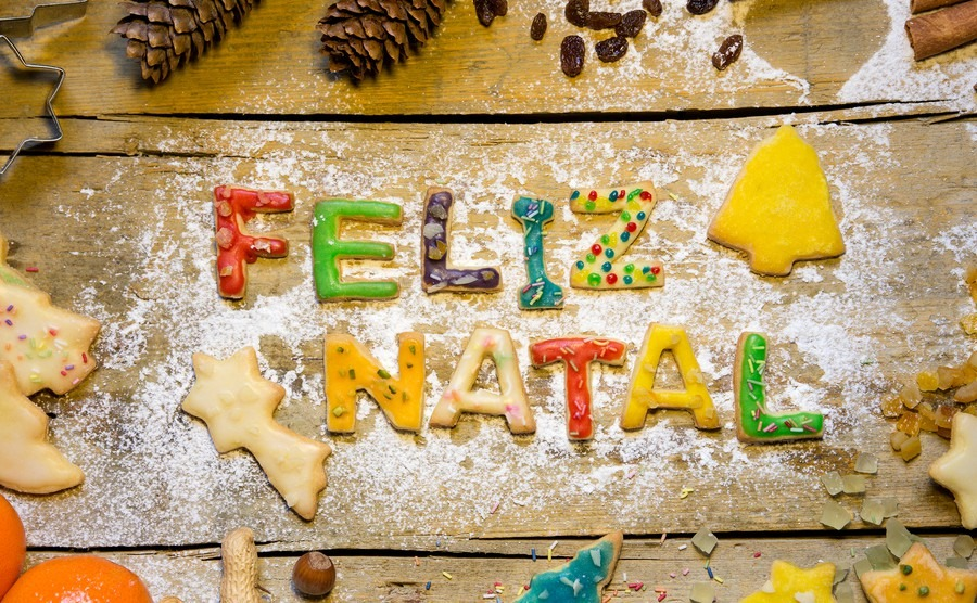 christmas-decoration-and-biscuit-letters-on-wood-portuguese-text-feliz-natal-which-means-merry-christmas