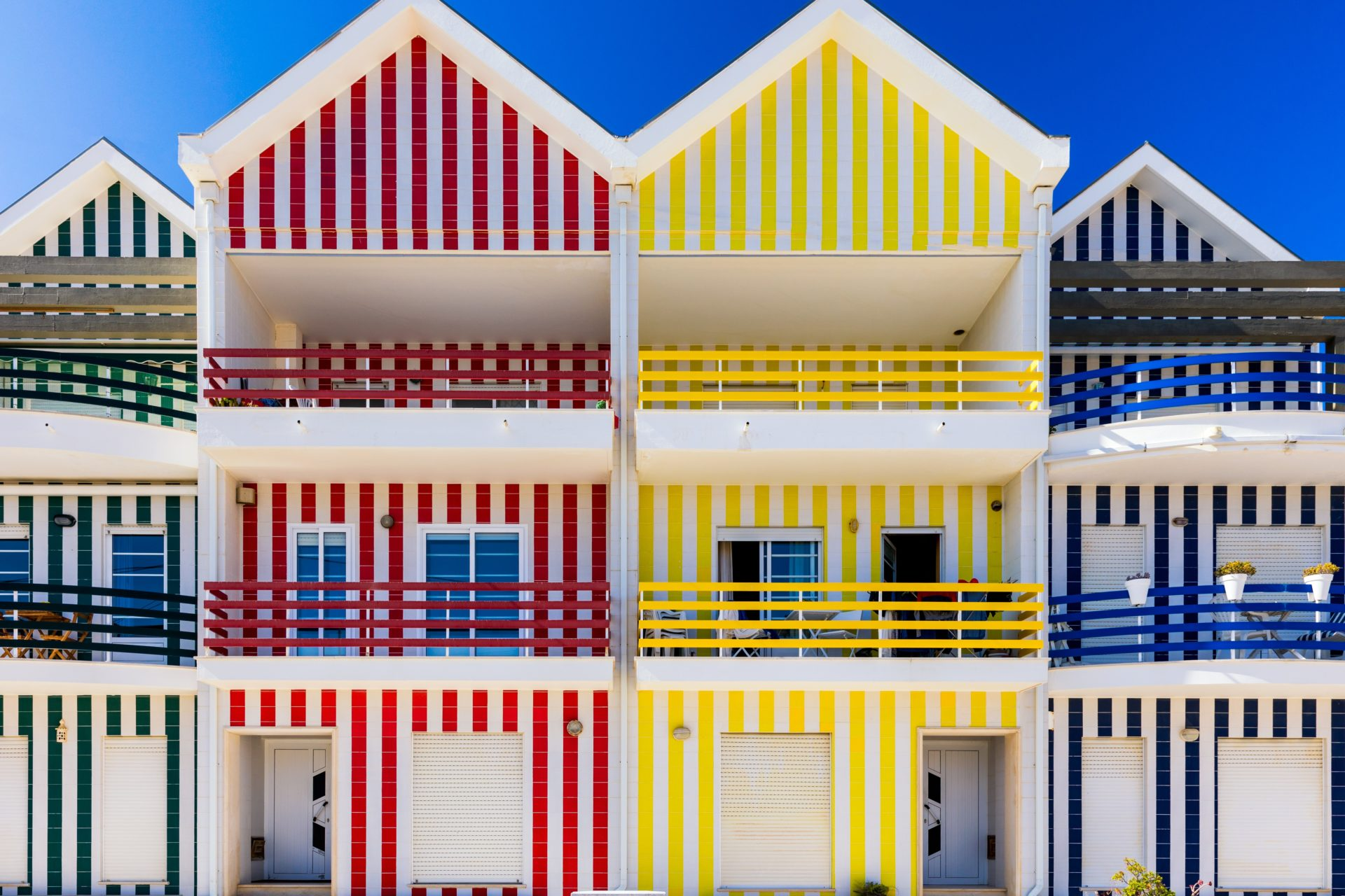 Facades of colorful houses in Costa Nova, Aveiro, Portugal.