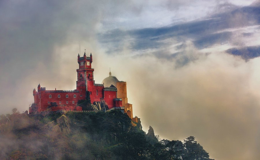 pena-national-palace-sintra-portugal-partly-covered-in-afternoon-fog-after-rain