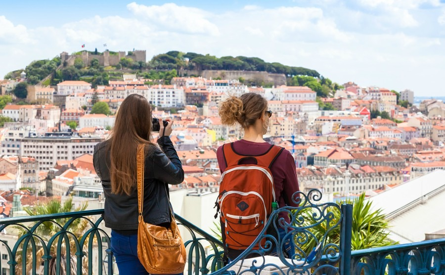 tourist-watching-to-lisbon-rooftop-from-sao-pedro-de-alcantara-viewpoint-miradouro-in-portugal