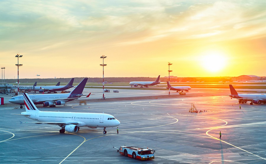 airport-with-many-airplanes-at-beautiful-sunset