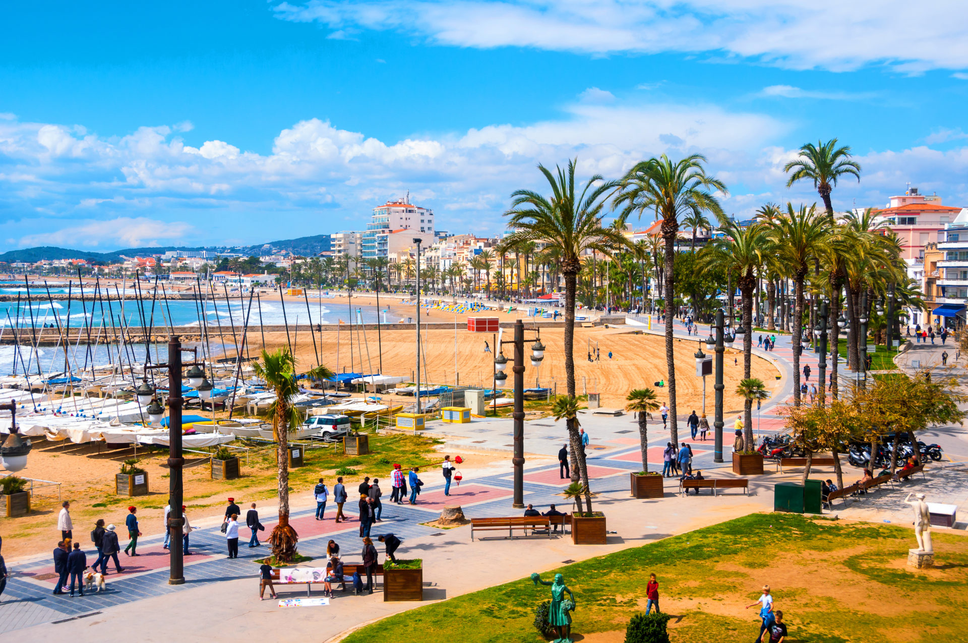 Golden beach and palm trees in Sitges