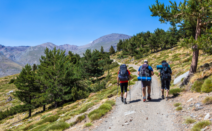 Make the most of the cooler weather and explore the great outdoors, like this trio heading to the Mulhacén.