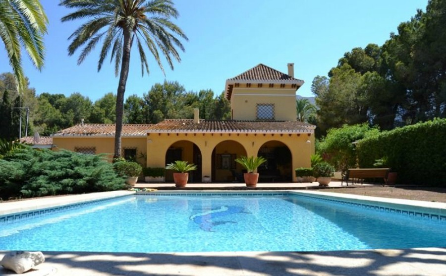 19th-century villa with spacious gardens and pool for €970,000.