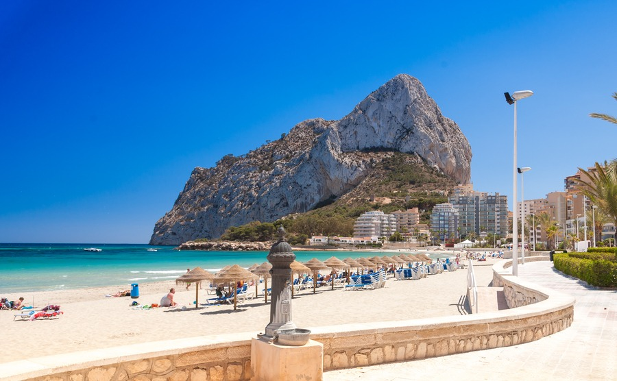 Sand beach and Natural Park of Penyal d'Ifac on background, Calpe, Spain