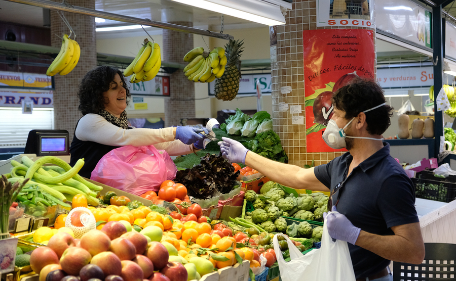 Markets, like this one in Alicante, are still open with sensible precautions being taken. Axel Alvarez / Shutterstock.com