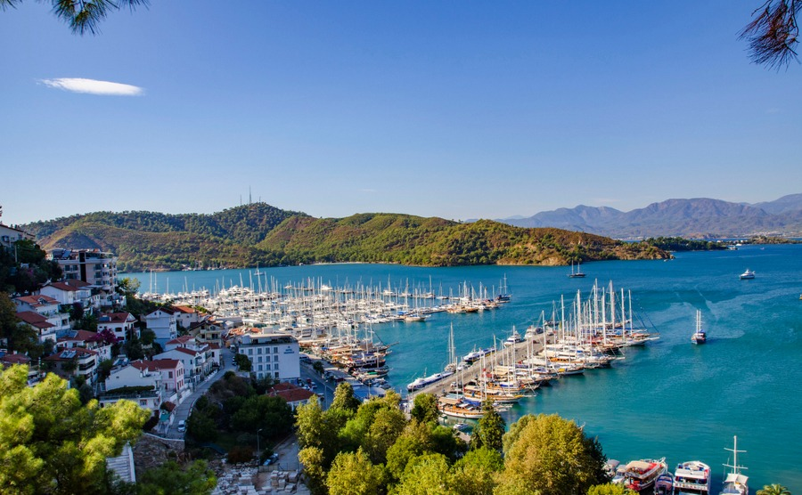 Turkey, Fethiye, view of the harbor with numerous yachts, and beautiful mountains in the background in the rays of the sun