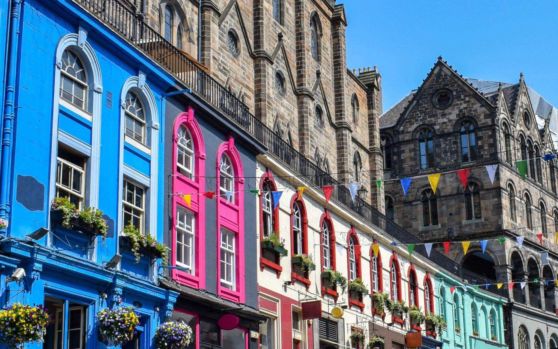 Colourful houses on Victoria Street in Edinburgh, a popular location for those deciding where to buy property in the UK