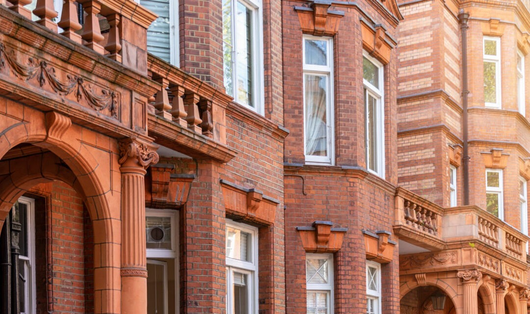What should you consider when buying a flat in the UK?