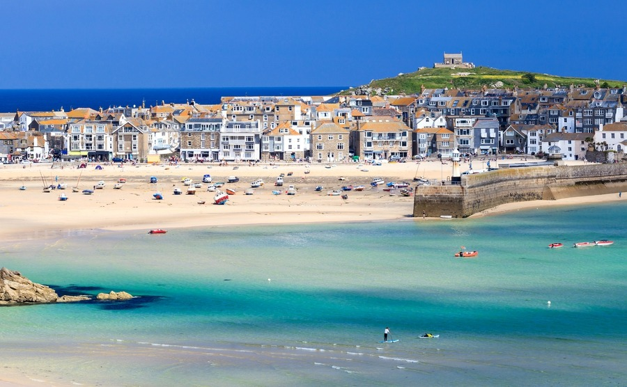 Beaches like Porthminster and an artistic scene make St Ives a popular place for buying a house in Cornwall.