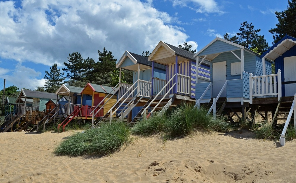 Beach huts on the sand near Cromer, Norfolk