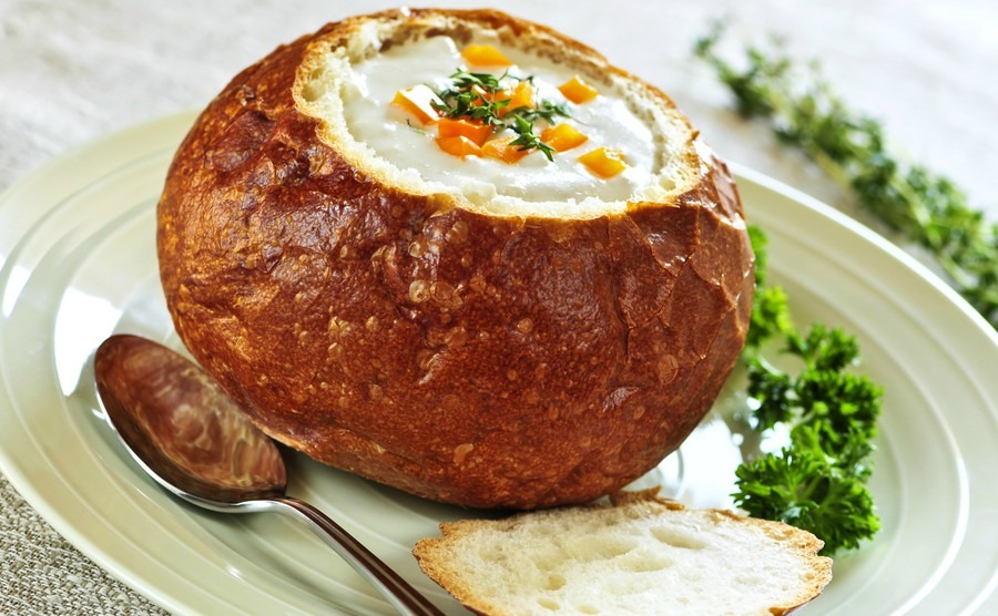 lunch-of-soup-served-in-baked-round-bread-bowl